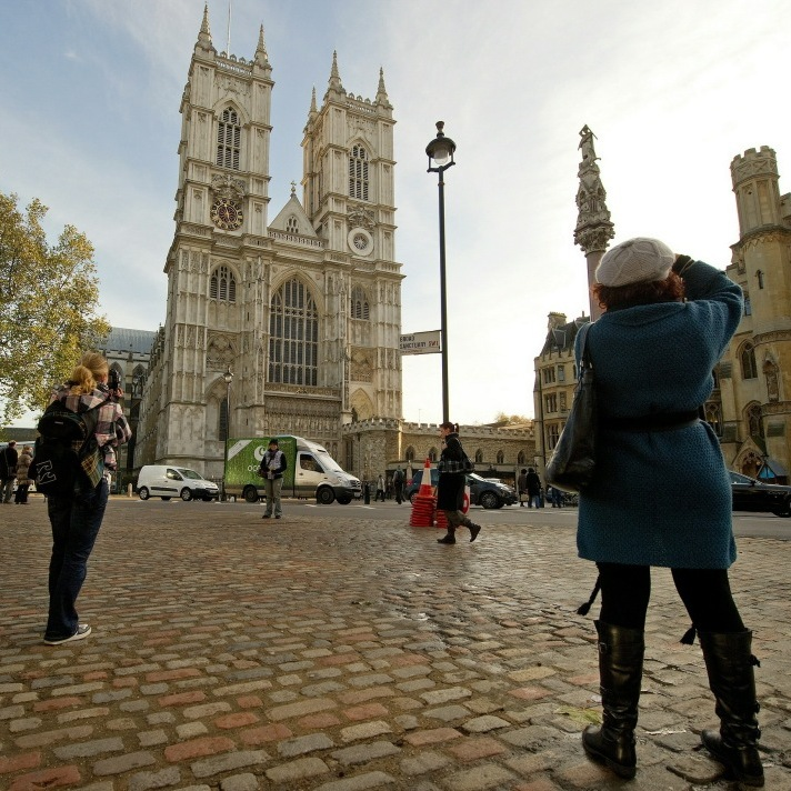 Tourists take photographs outside Westminster Abbey in central London on November 19, 2010. Britain'