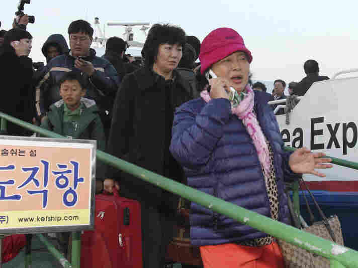 People from Yeonpyeong island arrived at Incheon port west of Seoul after fleeing the bombardment.