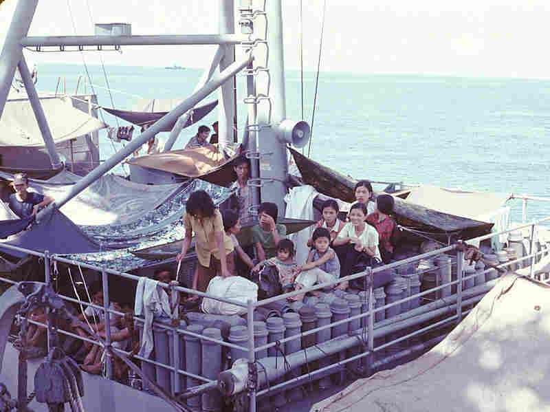 Refugees on Vietnamese vessel, part of the USS Kirk rescue mission.