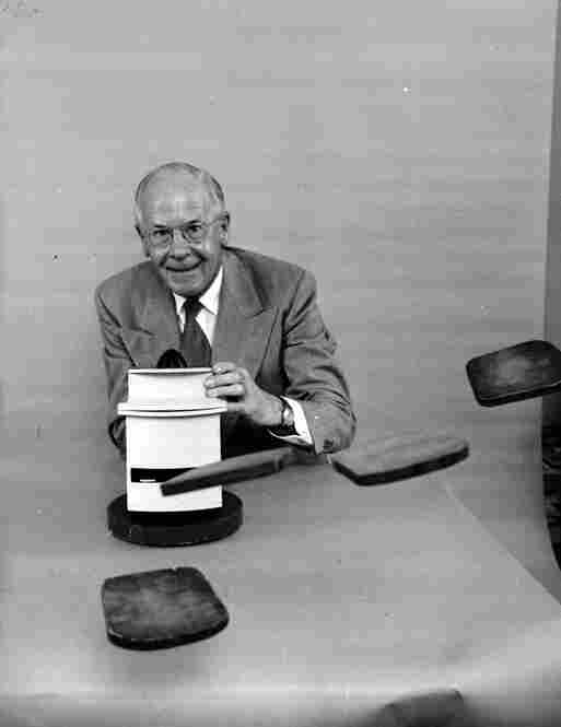 Oakes poses with his 'pop at you' toaster which ejects toast forcefully and horizontally.