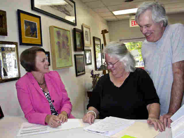 Health insurance broker Debbie Stocks (left) meets with Phyllis DeMaurizi and her partner Rick Michaels.