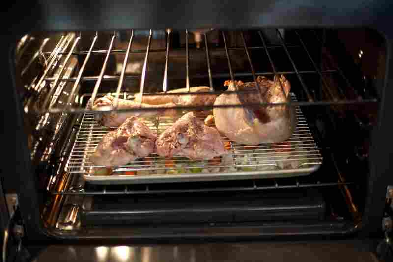 Kimball suggests slow-roasting turkey pieces over a baking sheet of onion, celery, carrot, thyme, garlic and broth.