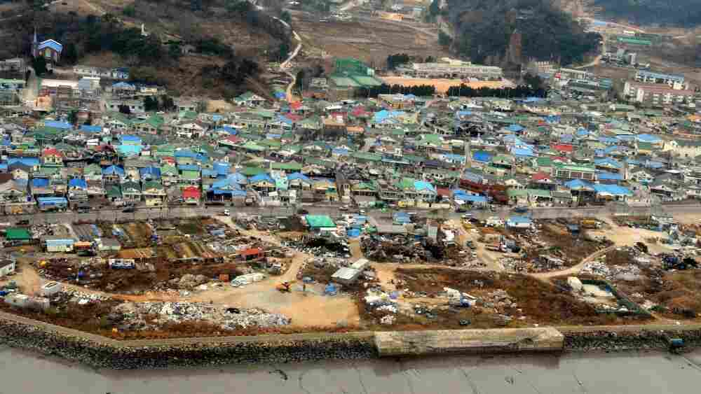 Destroyed houses are seen on South Korean-held Yeonpyeong island.