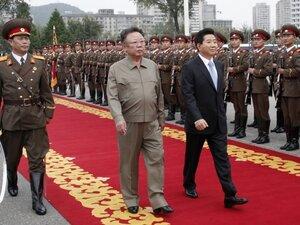 South Korea's President Roh Moo-Hyun and North Korean leader Kim Jong-il