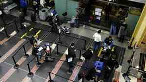 Travelers go through a security checkpoint at Reagan National Airport in Washington today.