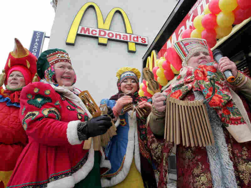 Traditionally dressed Russian musicians perform in front of Pushkin Square McDonald's