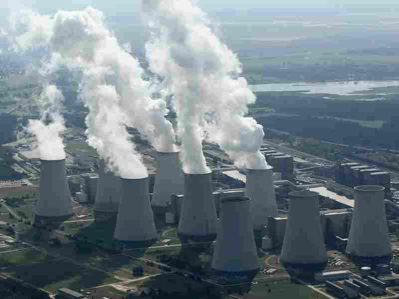 Steam rises from cooling towers at the Jaenschwalde coal-fired power plant in Germany