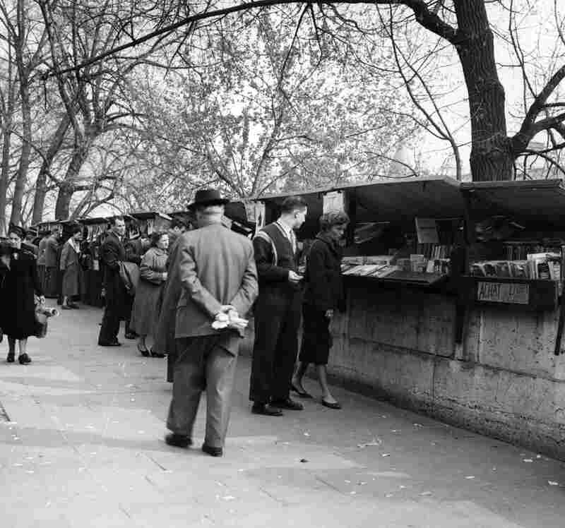 Shoppers browse the bookstalls along the Seine in April 1955.