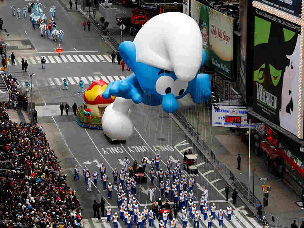 The Smurf balloon floats through Times Square during the Macy's Thanksgiving Day parade.