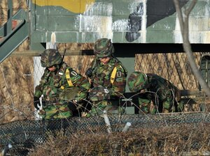 South Korean soldiers get out of a military truck.
