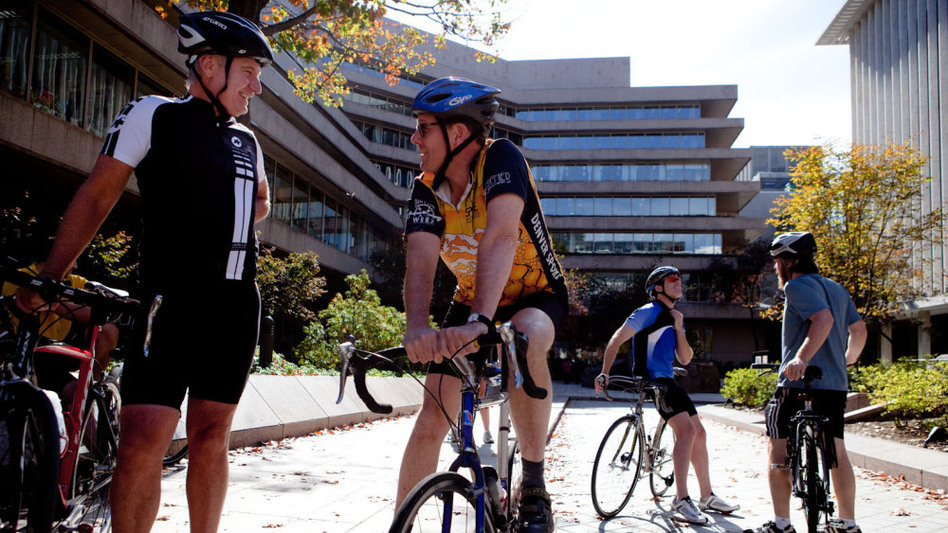 National Geographic Society CEO John Fahey talks with colleague Dan Westergren, who is also an avid cyclist.