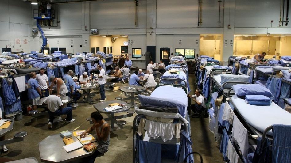 Inmates at the Mule Creek State Prison interact in a gymnasium that was modified to house prisoners in Ione, Calif. The U.S. Supreme Court hears arguments Tuesday in a case that pits California's  right to run its prisons against the Constitution's guarantee that individuals behind bars have a right to minimally basic medical care.