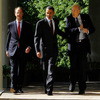 President Obama walking with Erskine Bowles and Alan Simpson.