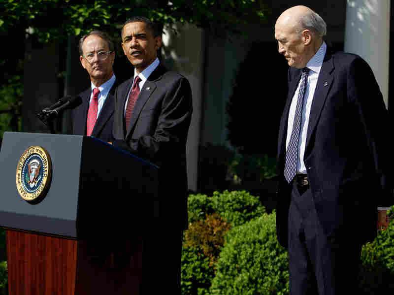 President Obama speaks in the Rose Garden as Erskine Bowles and Alan Simpson listen.