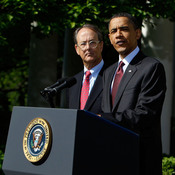 President Obama speaks in the Rose Garden as Erskine Bowles and Alan Simpson listen.