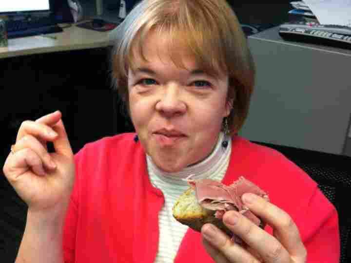 Lorna eats the sandwich.