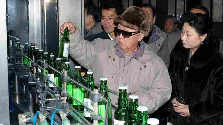 Kim Jong-Il at a bottling plant.