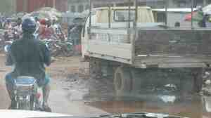 The view from inside a vehicle of the muddy road in the Red Light market of Paynesville, Liberia.