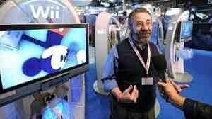 Mickey Mouse and Warren Spector.