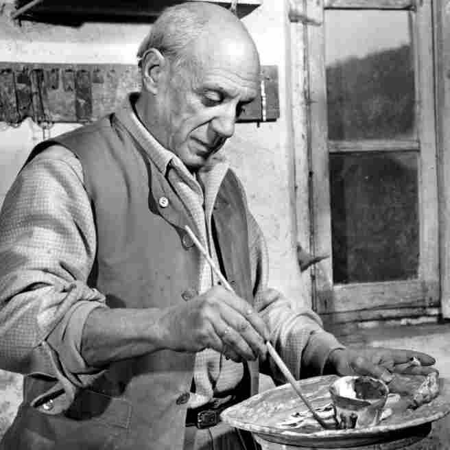 Spanish artist Pablo Picasso, 66, paints a plate in a pottery workshop in January 1948.