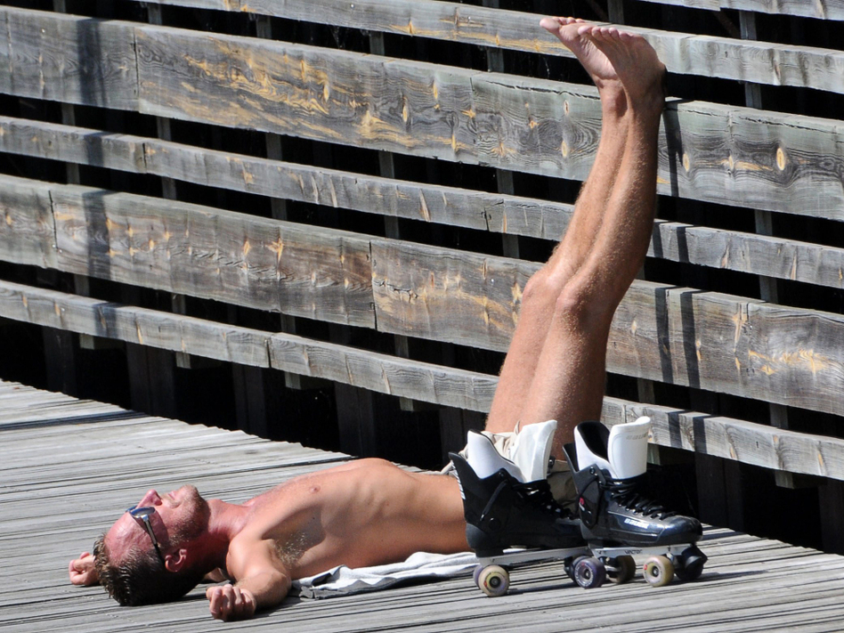 A man sunbathes in Malmo, Sweden, in July. Humans (and other animals) make vitamin D when exposed to sunlight.