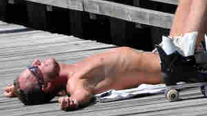 A man sunbathes in Malmo on July 8, 2010.