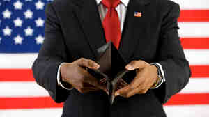 A man representing a lawmaker standing in front of a U.S. flag opens his empty wallet