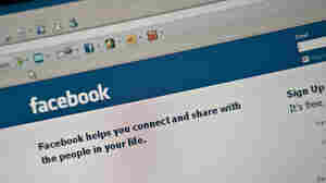 The Facebook homepage is seen on a computer screen.
