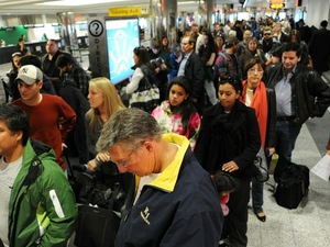 Travelers in a long check-in line