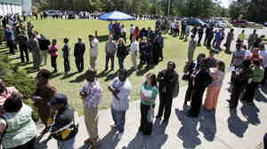 Job applicants stand in a line in Hanahan, S.C., in 2009 as they wait to get into a job fair.