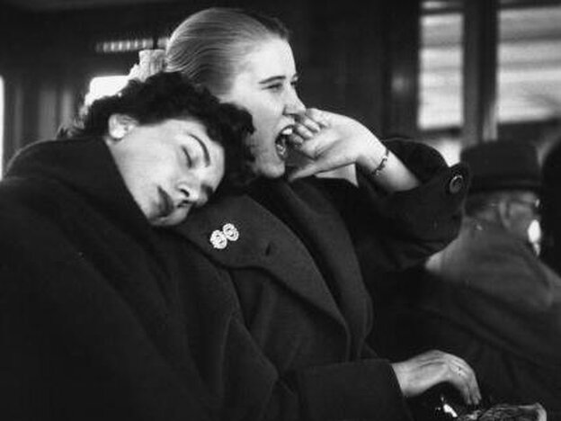 Jan 1, 1954: Tired passengers waiting for a  ferry in Liverpool.