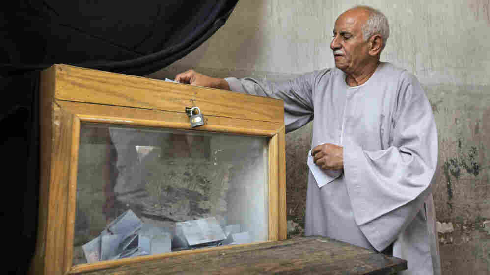 An Egyptian man in Cairo casts his vote in parliamentary elections, Nov. 28, 2010