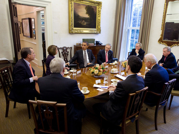 In this handout image provided by the White House, President Obama (center) and Vice President Biden (across the table from Obama) meet with congressional leaders in the President's Private Dining Room on Tuesday.