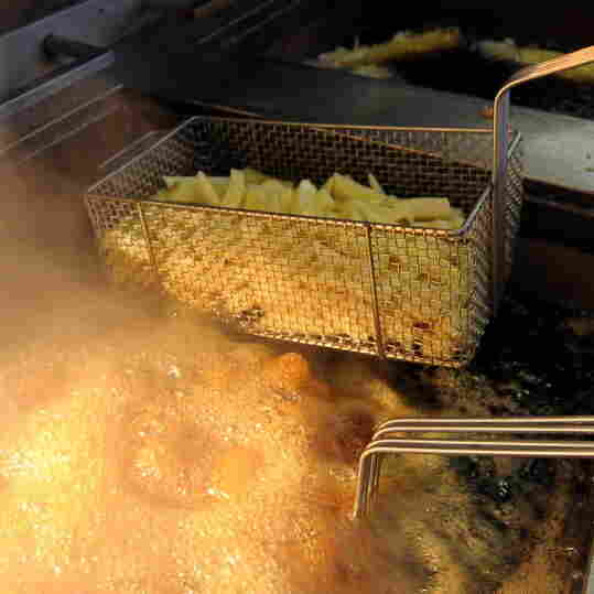 French fries in a deep fryer.