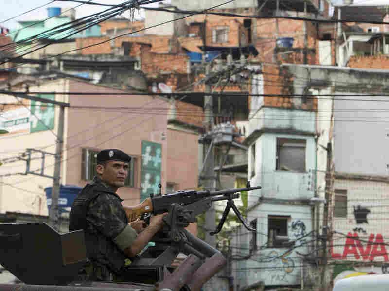 A soldier in an armored vehicle patrols the Complexo do Alemao slum in Rio de Janeiro