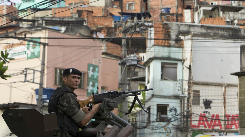 A soldier in an armored vehicle patrols the Complexo do Alemao slum in Rio de Janeiro on Tuesday.