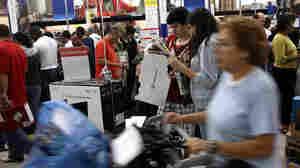 Black Friday Shoppers Hunt For Holiday Bargains