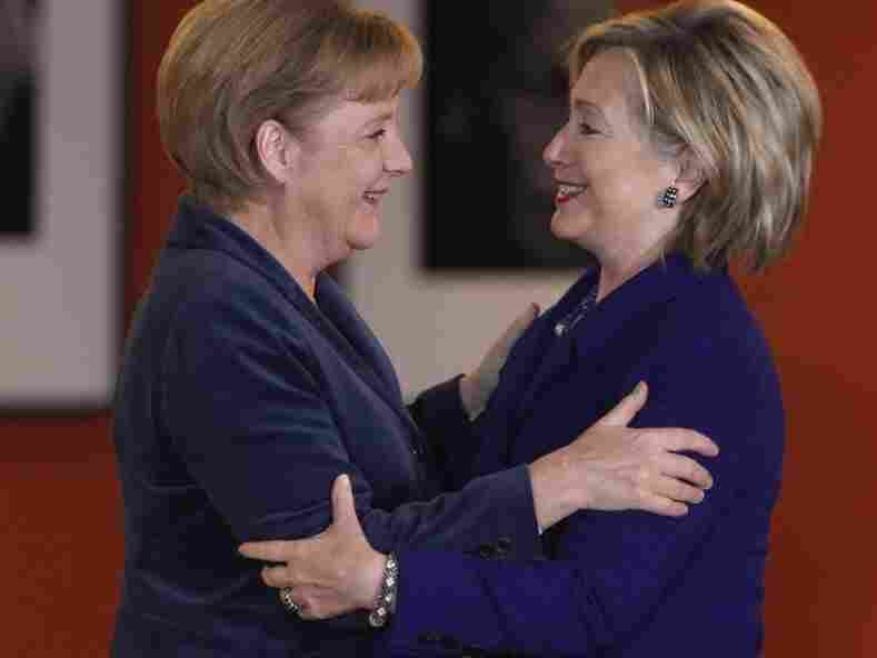 German Chancellor Angela Merkel greets U.S. Secretary of State Hillary Clinton