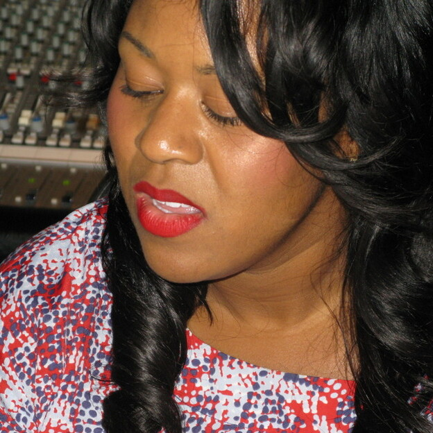 Songwriter and producer Makeba Riddick sings in a recording studio in Los Angeles. (NPR)