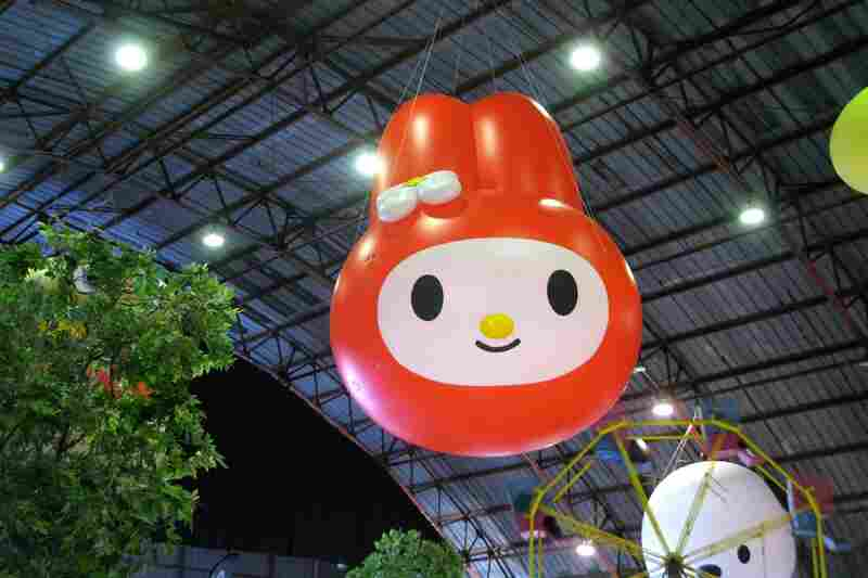 My Melody is just one of the rotund Sanrio characters' heads hanging from the ceiling of an airplane hanger in Santa Monica, Calif., at Sanrio's 50th anniversary carnival.