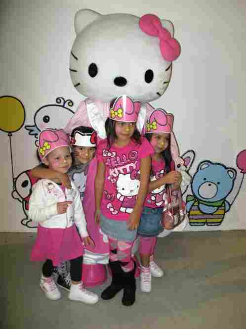 From left, Sofia Richards, 3; Cici Cortes, 5; Maya Cortes, 6; and Seila Richards, 4, meet Hello Kitty in person.