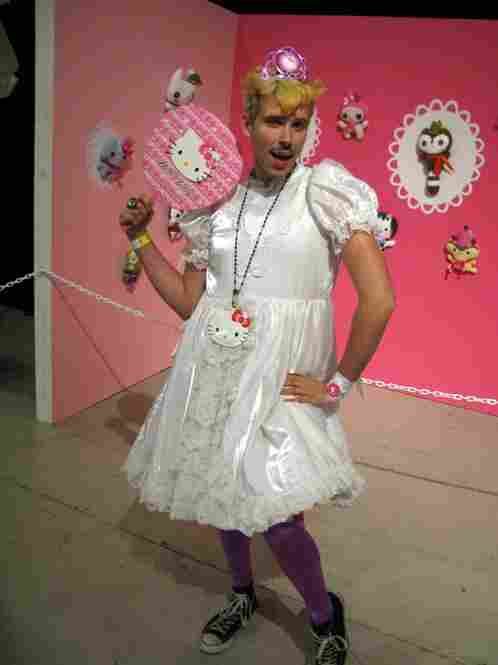 "Law school student Andrew Malagon, 23, sports a Hello Kitty tiara, dress and accessories. ""Hello Kitty's got attitude, a cute bow, she's fashionable and friendly,"" he says. ""She embodies what people would love to be."""