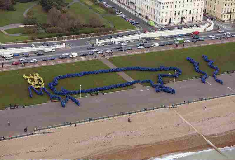 Nearly 2,000 people gathered in Brighton-Hove, UK and formed an image of King Canute, who futilely attempted to control the oceans according to legend. The image was designed by Radiohead's Thom Yorke.