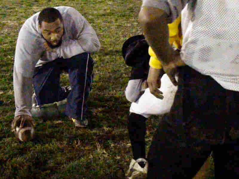 Assistant coach Stevie Draper runs drills with Blackhawks.