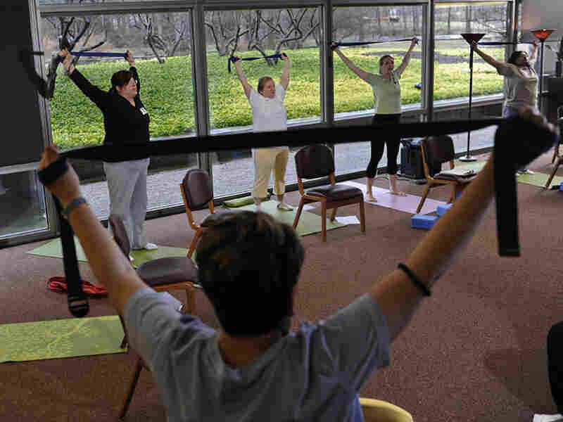 Patients with chronic diseases at the Cleveland Clinic learn to manage their pain using yoga and breathing.