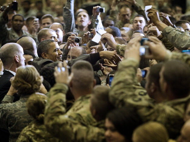 President Obama (at left) reaches out to troops at Bagram Air Field; Dec. 3, 2010.
