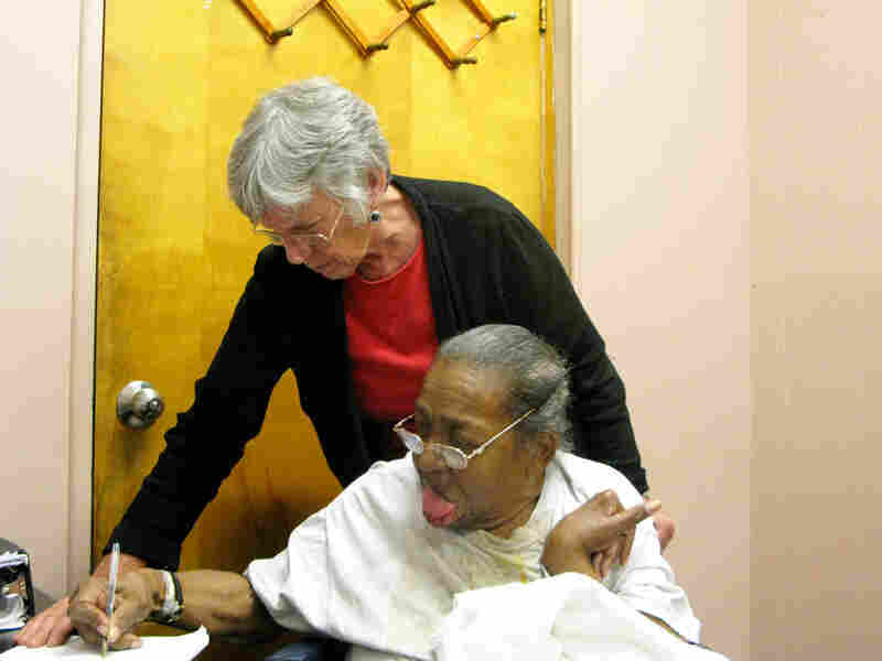 Delores Smith receives help from her attorney Sue Jamieson.