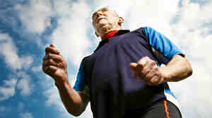 70-year-old man runs outdoors.