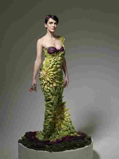 The artichoke gown was designed by Daniel Feld and Wesley Nault of Project Runway fame. It took over 6 hours to finish (the model stood the entire time while they attached each, individual leaf).