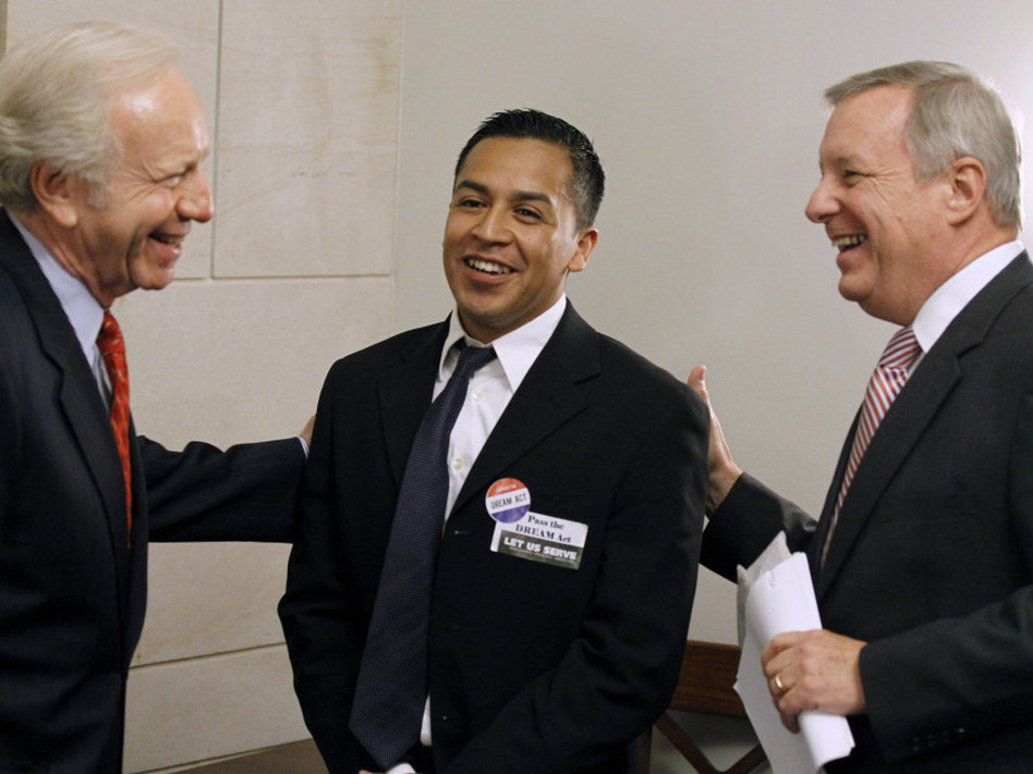 Sens. Joseph Lieberman of Connecticut (left) and Richard Durbin of Illinois (right) talk with Cesar Vargas, a law student from New York City, on Capitol Hill in September. Vargas is one of some 2 million young people who would qualify for legal residency under the DREAM Act.